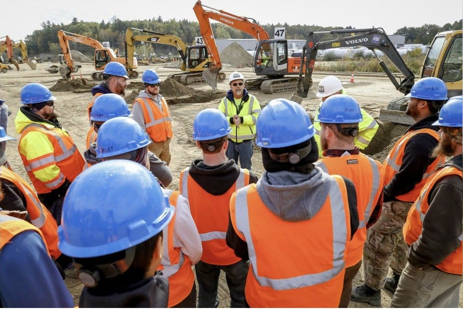 Here is a group of our heavy equipment training students gathered in a meeting with an instructor. Our heavy equipment operator school is close to you. Just a bus or plane ride away.